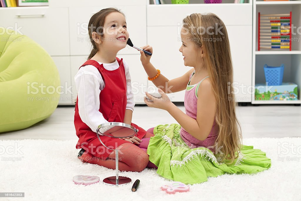 Applying powder on face royalty-free stock photo