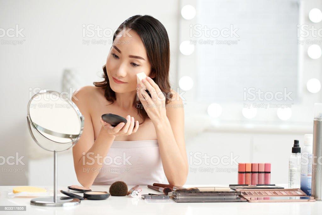 Applying powder stock photo