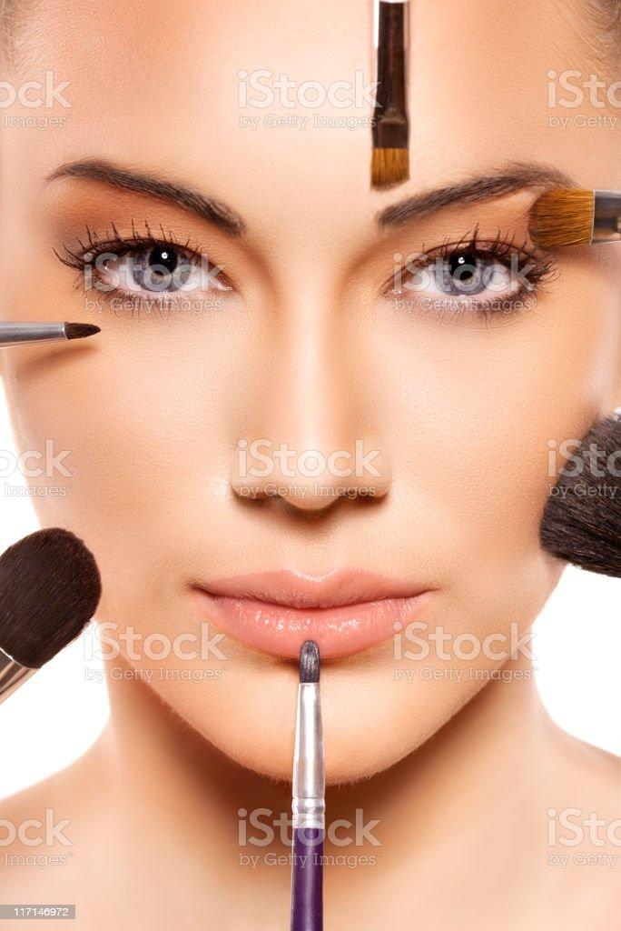 Applying professional make up royalty-free stock photo