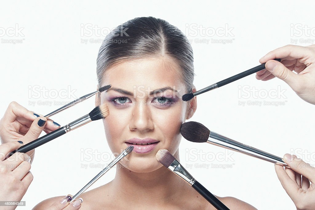 Applying Professional Makeup royalty-free stock photo