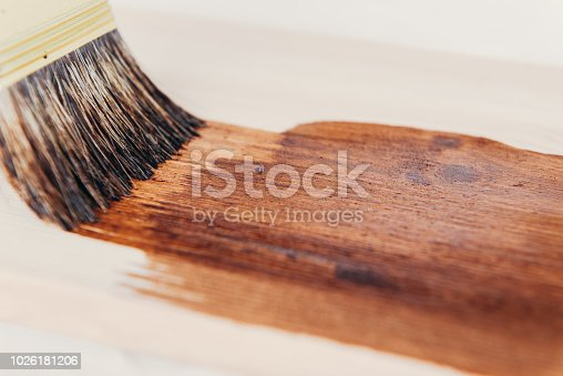 istock Applying protective varnish on a wooden surface dyi 1026181206
