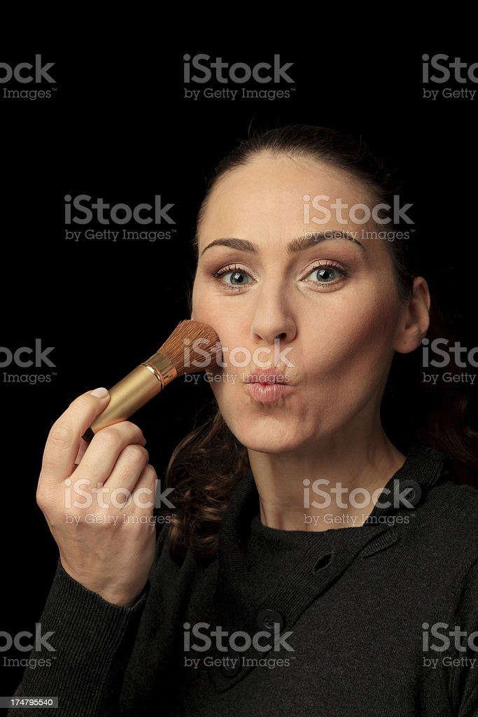 applying rouge on the cheeks royalty-free stock photo