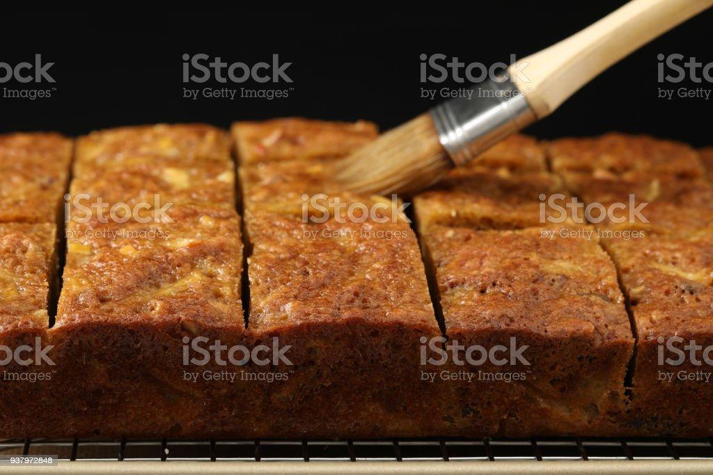 Applying Rum To English Fruit Cake stock photo