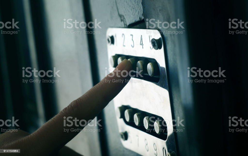 Applying security code on the door stock photo