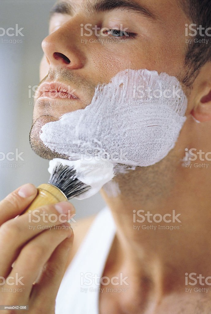 Applying shaving foam royalty-free stock photo