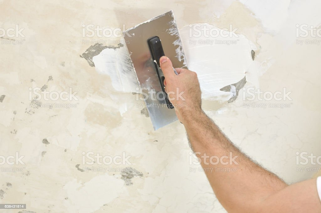 Applying Spackling Compound stock photo