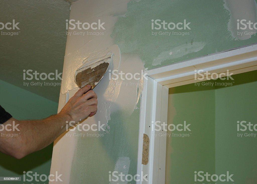 Applying Spackling on Drywall stock photo