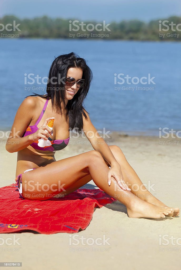 Applying sunscreen royalty-free stock photo