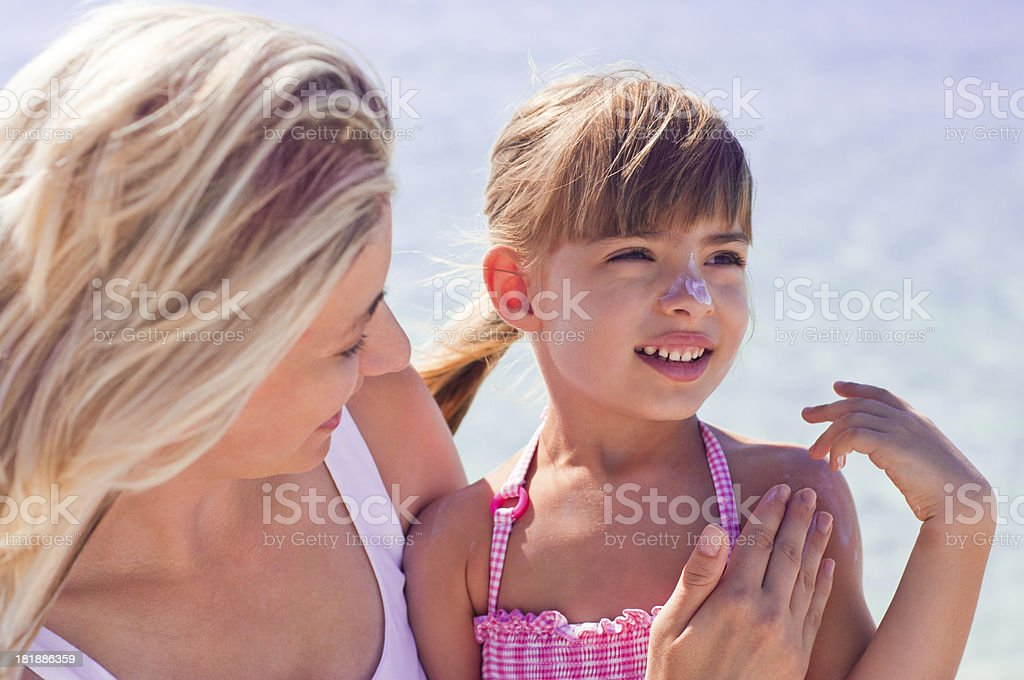 Applying suntan lotion royalty-free stock photo
