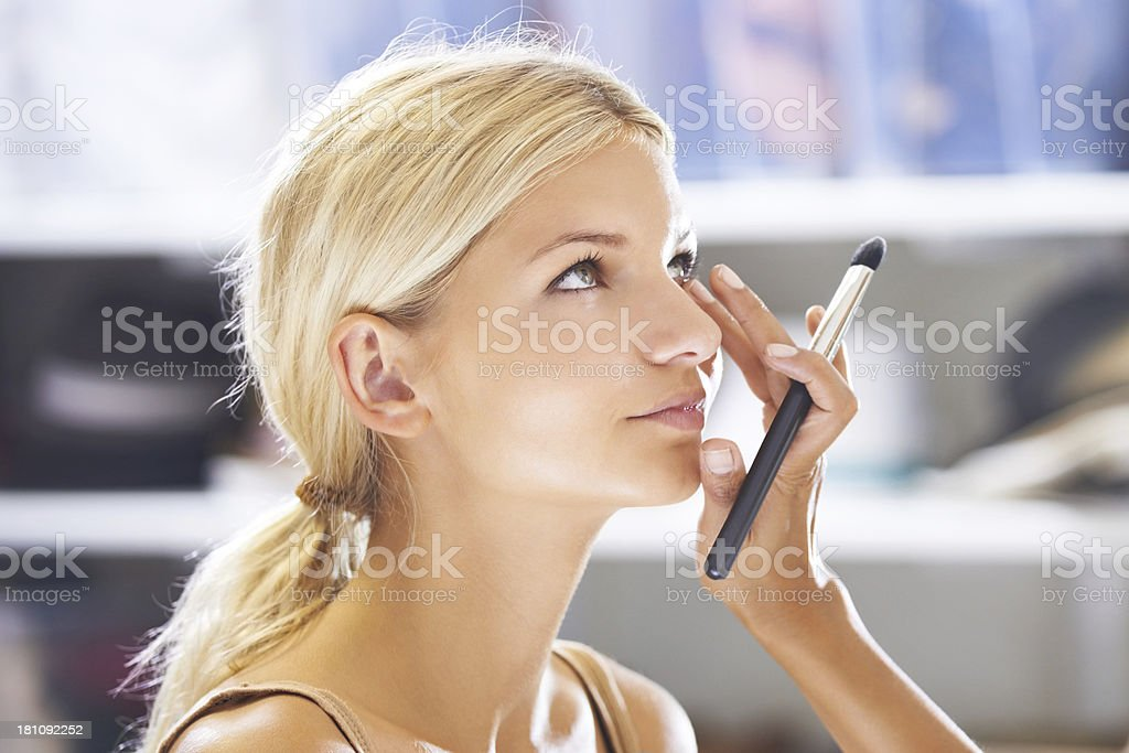 Applying the right color concealor stock photo