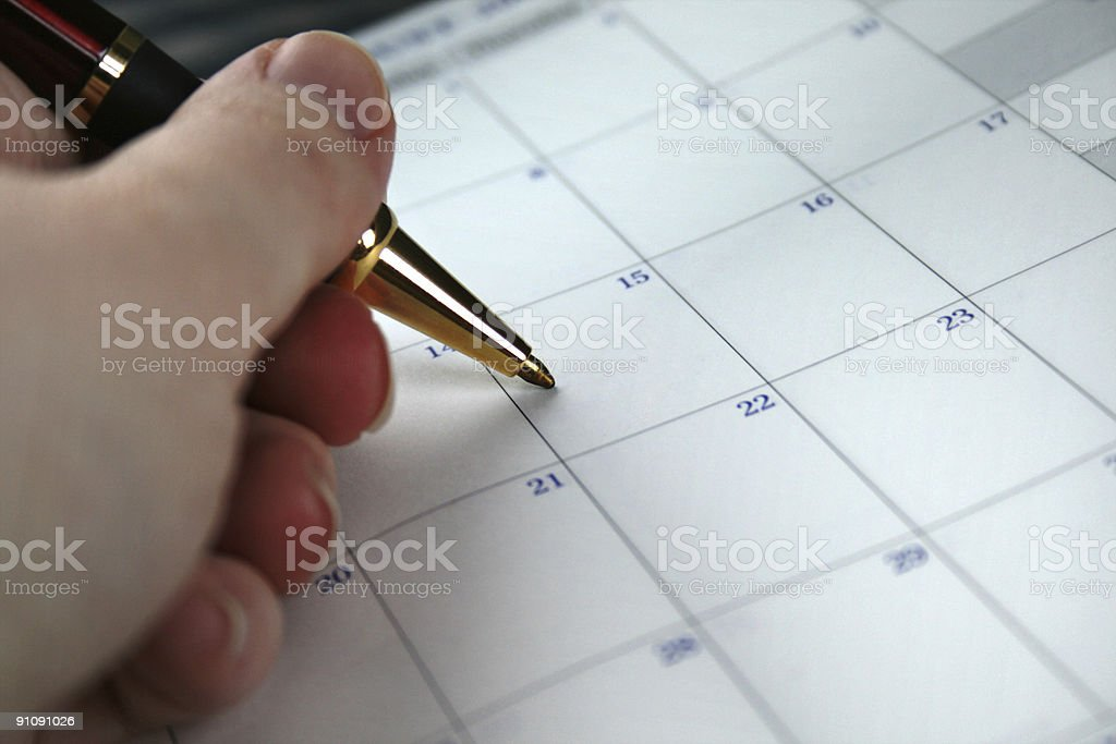Appointment Book: Person Writing Marking the Date stock photo