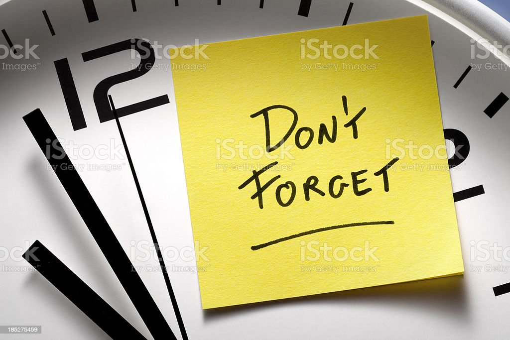 Appointment reminders. Clock with yellow sticky note. royalty-free stock photo