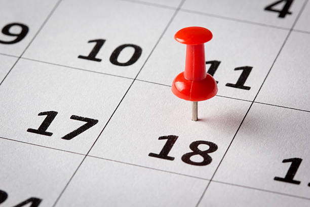 appointments marked on calendar - number 18 stock photos and pictures