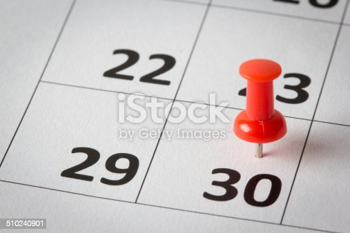 Concept image of a calendar with red push pins. Available in high resolution