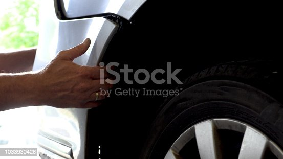 istock Appraiser checks damage to the vehicle 1033930426