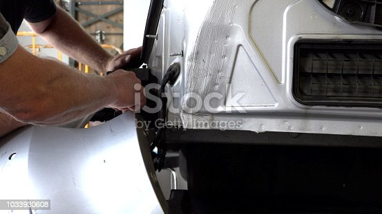 istock Appraiser checks damage to the vehicle 1033930608
