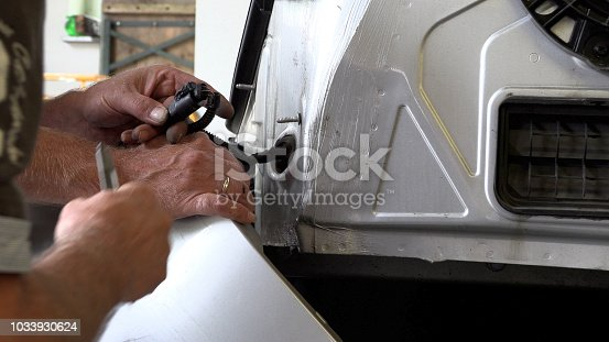 istock Appraiser checks damage to the vehicle 1033930624