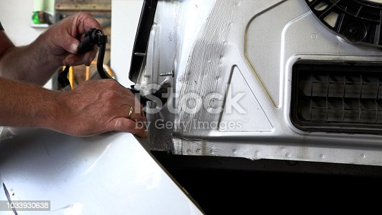 istock Appraiser checks damage to the vehicle 1033930638