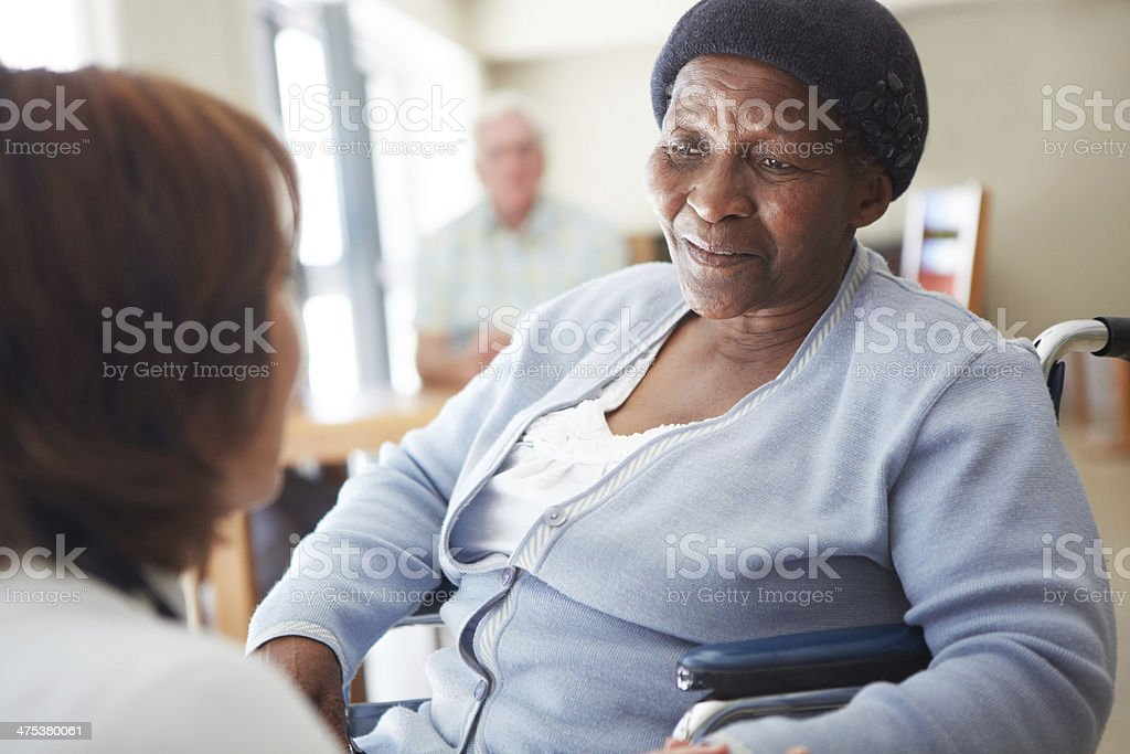 Appreciating a kindly word from her caregiver stock photo