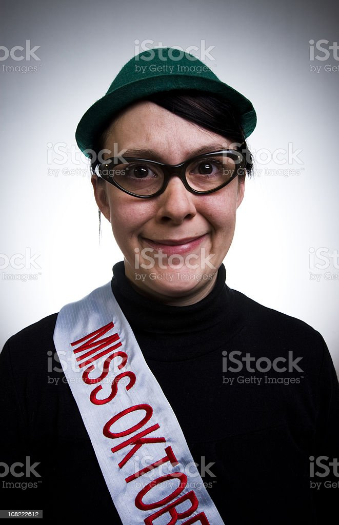 Apprehensive Woman Wearing Miss Oktoberfest Sash and Hat royalty-free stock photo