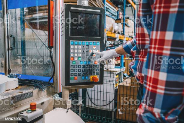 Apprentice engineer male hand working with cnc machine in factory picture id1132975900?b=1&k=6&m=1132975900&s=612x612&h=gbtslfe3kyii2ptuocutwr44j2antcimkd7 ochuyk4=