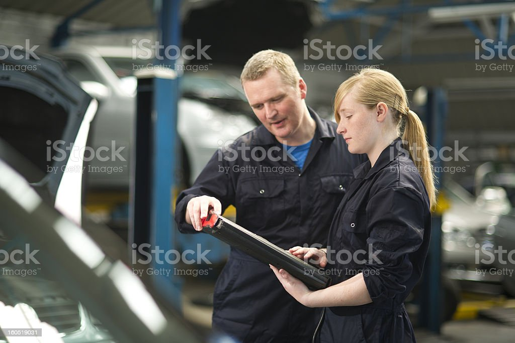 apprentice in the garage royalty-free stock photo