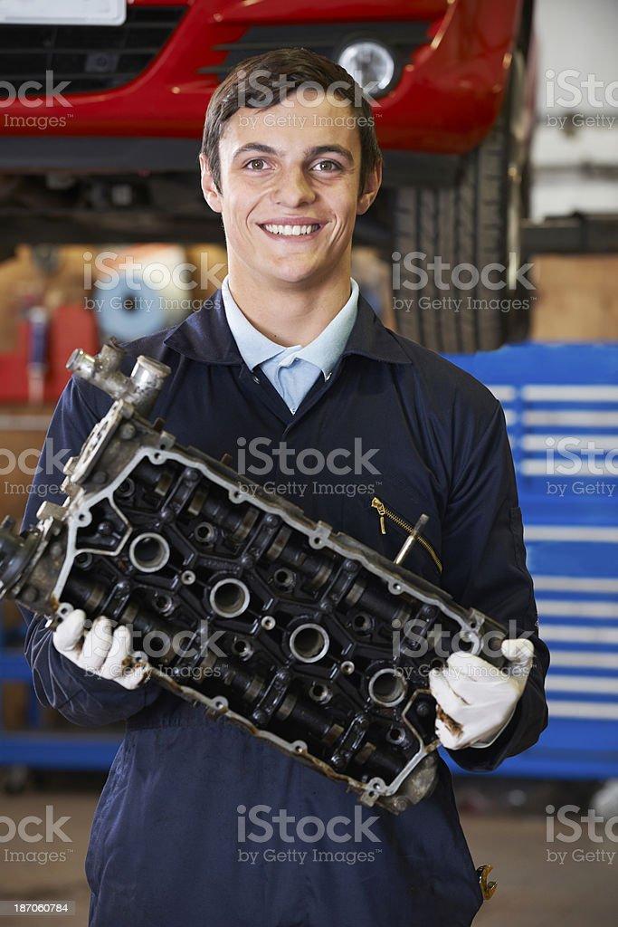 Apprentice Mechanic Holding Engine Block royalty-free stock photo
