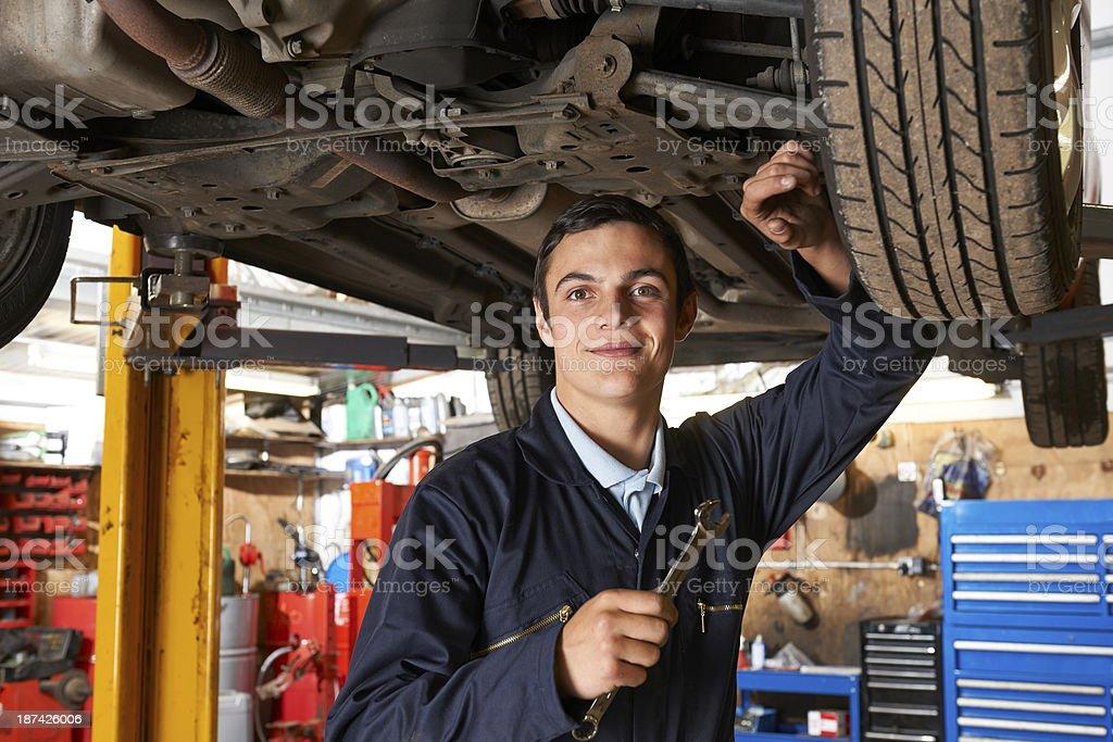 Apprentice Mechanic Working On Car royalty-free stock photo