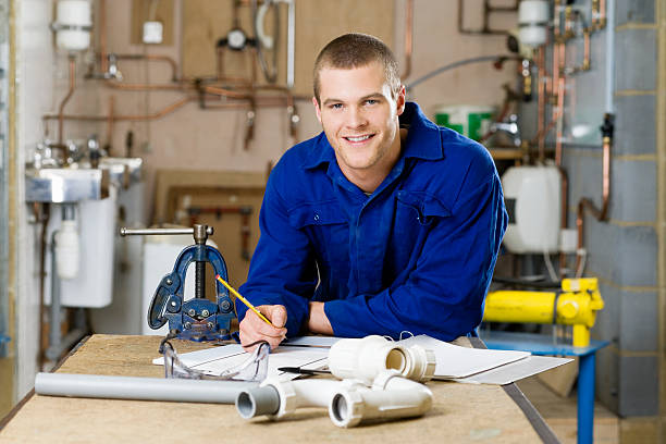 Apprentice plumber  bib overalls stock pictures, royalty-free photos & images