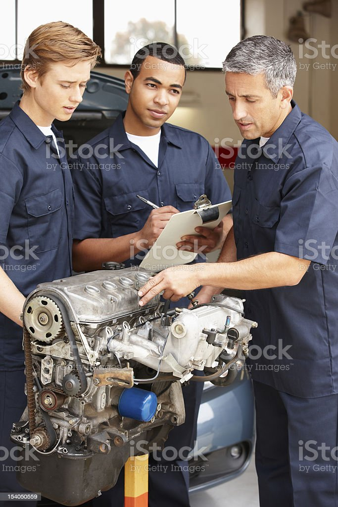 Apprentices at mechanics royalty-free stock photo