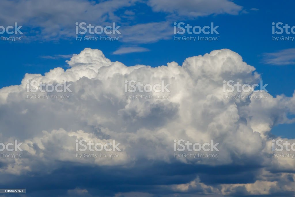 A large storm cloud announces the approaching storm. The storm is...