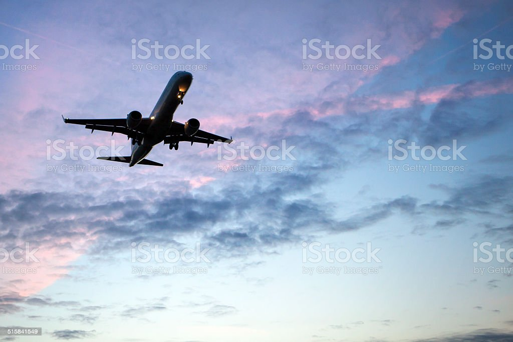 Approaching airplane at dawn stock photo