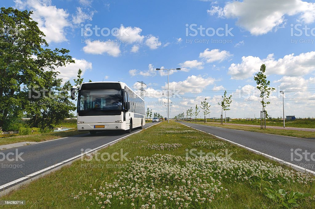 Approaching bus in dutch landscape stock photo