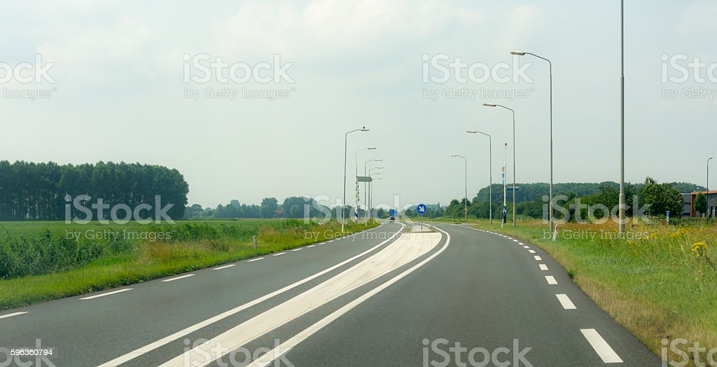 approaching intersection double solid line on dutch rural road royalty-free stock photo