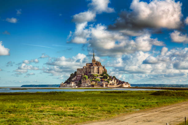 Approaching Saint Michael's Mount, Normandy, France Approaching Saint Michael's Mount, Normandy, France manche stock pictures, royalty-free photos & images