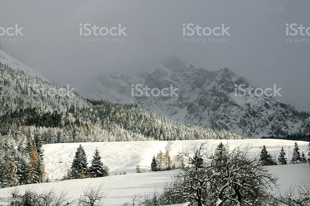 approaching snow clouds stock photo
