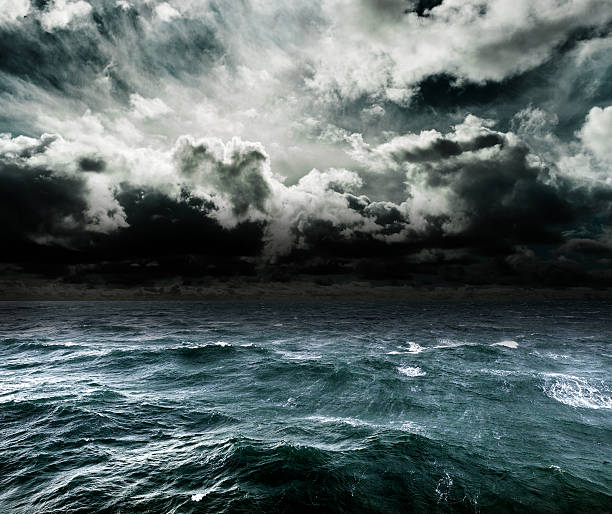 approaching storm over the ocean. - rough stock photos and pictures