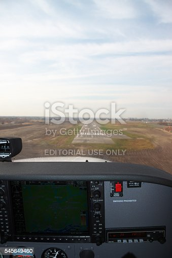 Kiev, Ukraine - November 12, 2010: Approaching the runway for landing from the cockpit of the Cessna 172 Skyhawk