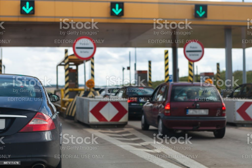 Approaching toll gates at highway stock photo