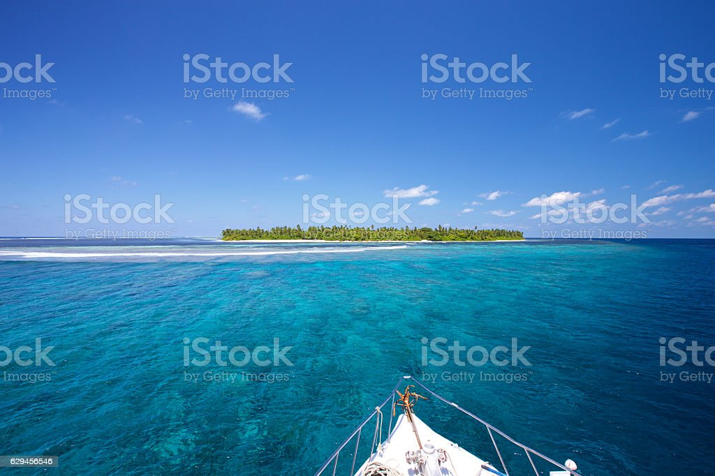 Approaching Tropical Island by Boat. stock photo