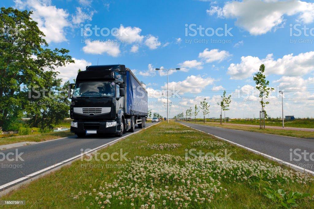Approaching truck in dutch landscape stock photo