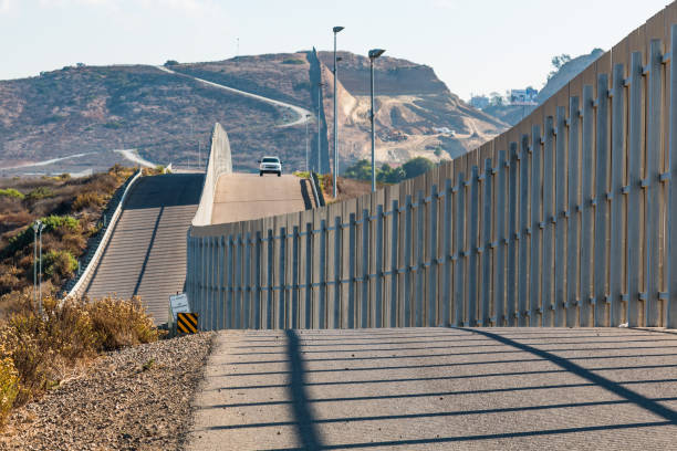 Approaching U.S. Border Patrol Vehicle at U.S./Mexico Border Wall stock photo