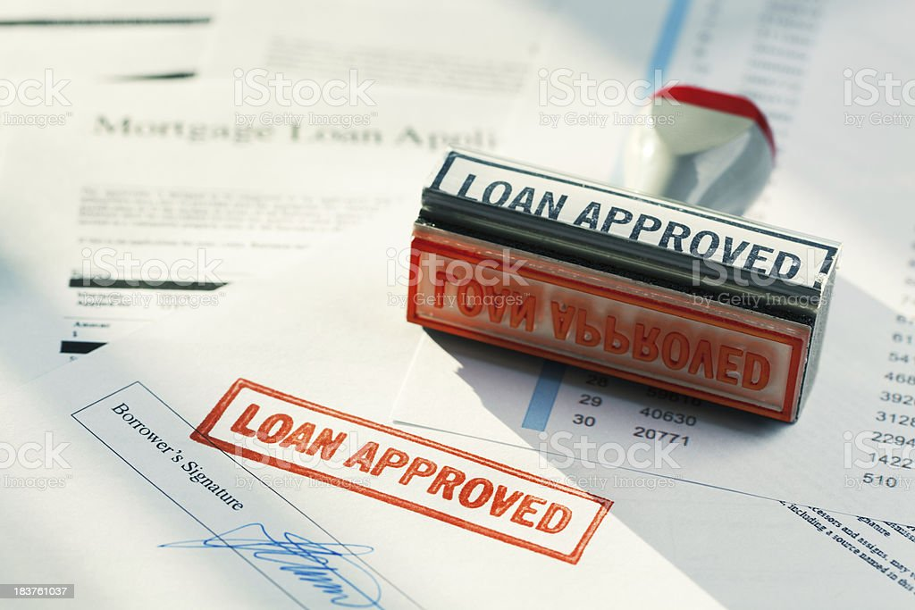 """LOAN APPROVED"" Approval Red Rubber Stamp Approving Mortgage Application Document stock photo"
