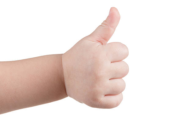 Approval thumbs up like sign, caucasian child hand gesture isolated stock photo