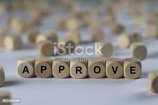 istock approve - cube with letters, sign with wooden cubes 800468388