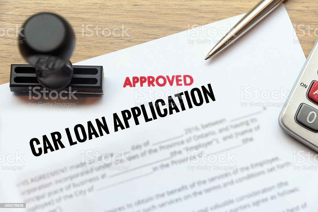 Approved car loan application form lay down on desk stock photo