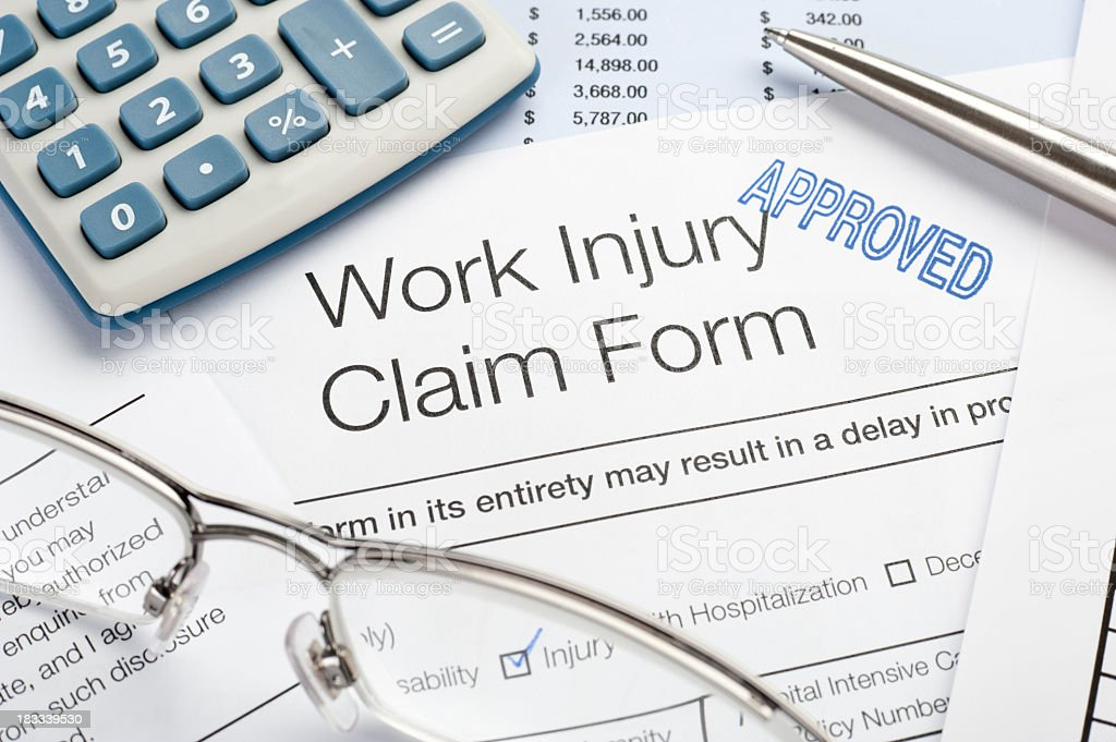 Approved Claim Form for a work injury stock photo