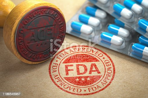 istock FDA approved  concept. Rubber stamp with FDA and pills on craft paper. 1186545957