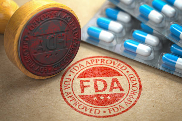 fda approved  concept. rubber stamp with fda and pills on craft paper. - fda stock photos and pictures