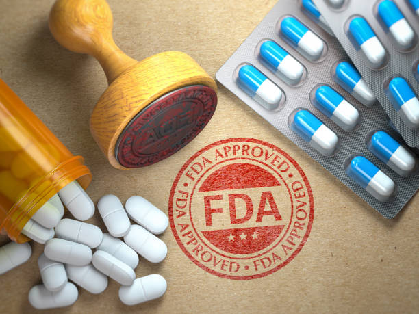 FDA approved  concept. Rubber stamp with FDA and pills on craft paper. stock photo